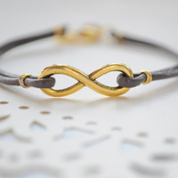 Infinity Bracelet- Golden infinity sign and leather cord