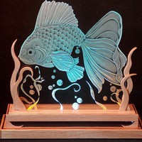 Carved Glass Goldfish in Oak Base Lit with by braithwaitestudios