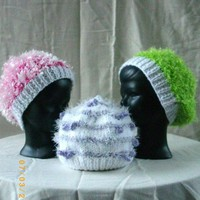 Handknit hats for baby in green, pink, purple and white