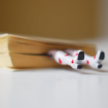 Legs in the book White boots with red hearts st by MyBookmark