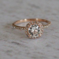 White sapphire diamond ring a 14k rose gold diamond setting