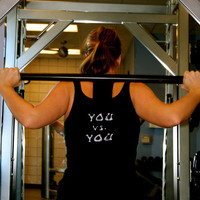 You versus You done in vintage looking silk screen on a black workout tank top with a plain front