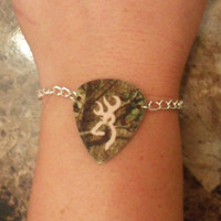 Mossy Oak Camo with light pink browning deer symbol guitar pick bracelet jewelry