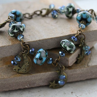 Bronze Moon Charm Bracelet with Blue and Green Lampwork Beads and Blue Crystals