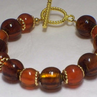 Rootbeer and honey glass bead bracelet by poshandplayful on Etsy