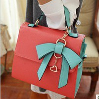 Unique dimensional bow handbag