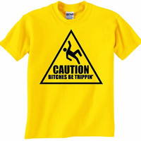 CAUTION BITCHES be TRIPPIN' tshirt available in by HappyGoatShirts