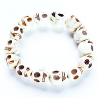 Stone cream skull bracelet