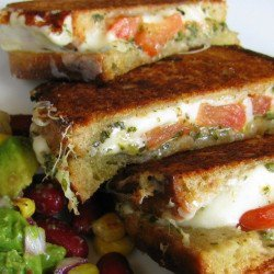 Food / grilled cheese with avocado, mozzarella, tomato and pesto!