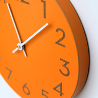 orange spice wall clock with modern numbers