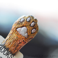 Cat paw. Orange paw in the book. Funny gift. Cat in book for child, children, kids, for her, all, hostess. theteam