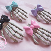 Skeleton hand hair clip with bow