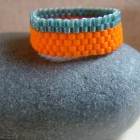 Beaded ring in tangerine orange and ocean teal by ElephantBeads