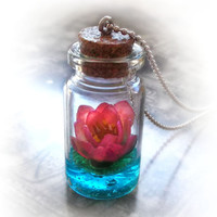 Lotus flower on a magic lake bottle necklace