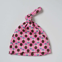Baby girl newborn knot hat. (0-2 months/XS)  Pink with floral designs.     (Made by lippy brand)