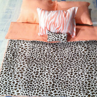 Reversible cheetah and peach bedding with 4 pillows