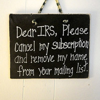 Dear IRS sign painted on wood