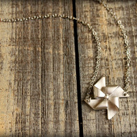 Pinwheel Necklace in Matte Silver by saffronandsaege on Etsy