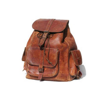vintage distressed brown rugged leather back pack by TanakaVintage