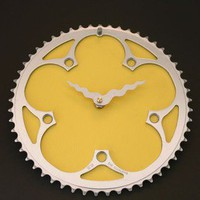 yellow recycled bike clock