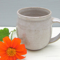 white handmade coffee mug