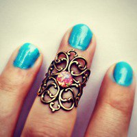 alapop — Antique brass and pink opal above the knuckle ring
