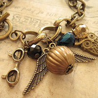 Snitch Harry Potter inspired charm bracelet by trinketsforkeeps