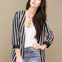 Black and white vintage striped blazer with lightly padded shoulders.  | shopcuffs.com