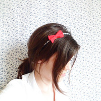 Red bow on a daisy pattern headband by NatbeesFashion on Etsy