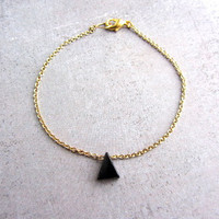 Gold bracelet with a tiny black onyx triangle gemstone. Simple dainty Geometric charm bracelet.