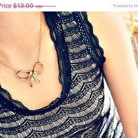 ON SALE bow necklace