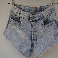bleached light blue levis high waisted cut offs size by Deadenim