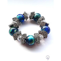 Blue and Turquoise Bead Stretch Bracelet With White Crystal Beads and Pewter Flower Spacer Beads