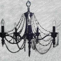 Black chandelier with beads and great details by Emmanddoubleyas