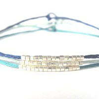 Feather Bracelets by BrooklynThread on Etsy