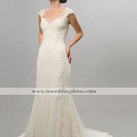 unusual wedding dress with lace and beading, elegant bridal gown