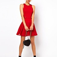 ASOS PETITE Exclusive Mini Dress With Drop Waist And Button Detail at asos.com