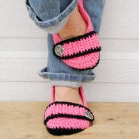 Bold pink with black crocheted slippers, booties, shoes, socks with a button strap.