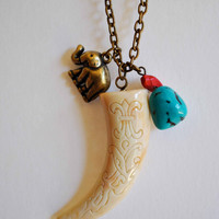 HORN NECKLACE with elephant and turquoise.