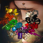 Kitsch Rainbow themed loaded gumball charm bracelet full of multi coloured plastic gumball charms chunky bracelet