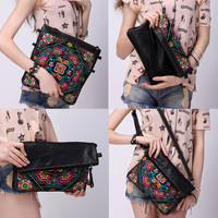 20% OFF - 6-Way Embroidered Clutch Purse