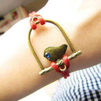 Adjustable Vintage Bird Bracelet with Red hemp by sevenvsxiao