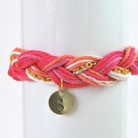Personalized bracelet with hand stamped initial on brass charm, pink friendship bracelet