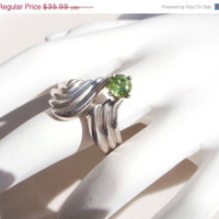 Spring Fashion Sale Vintage Sterling Silver Peridot Ring size 8 with swirl design