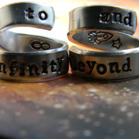 to infinity and beyond set of  of two aluminum swirl style  rings 1/4 inch