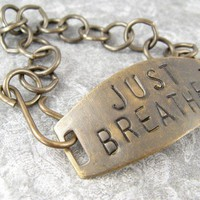 Just Breathe hand stamped brass metal bracelet by CobwebCorner