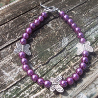 Purple bracelet, silver butterfly accents, toggle closure