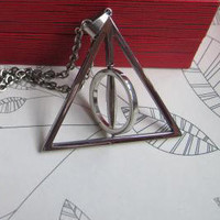 Harry potter Deathly Hallows Middle Resurrection Stone Can spin Necklace,Harry potter Deathly Hallows Middle Can spin Necklace