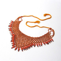 Vintage 1980s orange and navy seed glass bead bib necklace