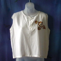 White sleeveless rayon top with hand-painted floral embellishment. size medium